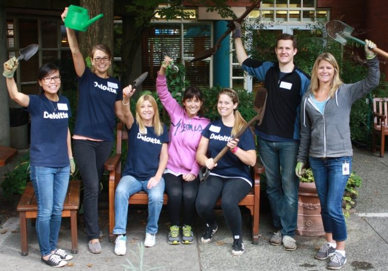Volunteers from Deloitte Help out in our Garden
